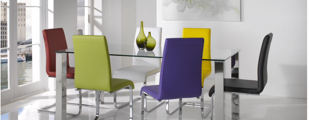 Rectangle glass top dining table with six colorful chairs in a white room